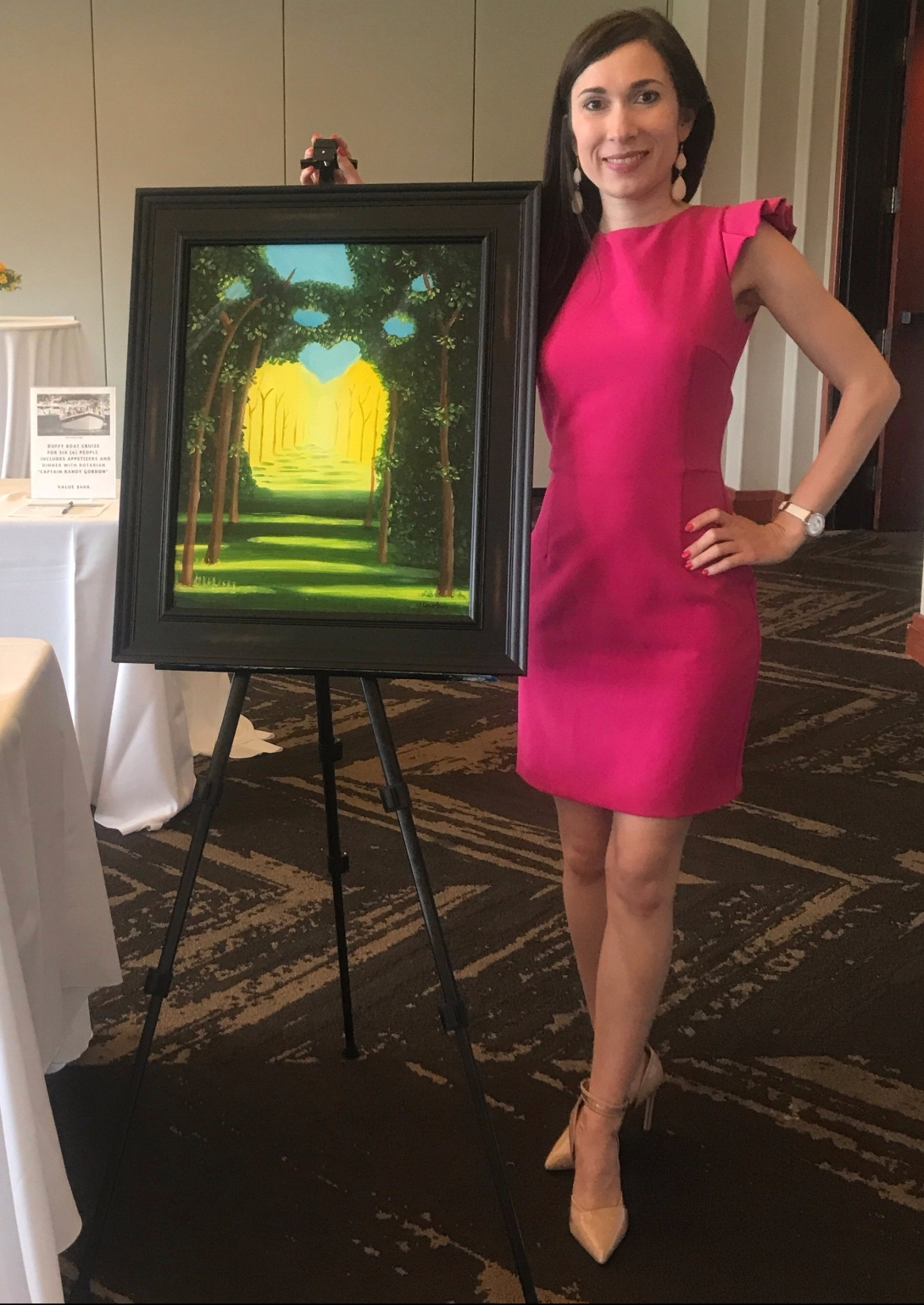 Ylenia Mino standing next to one of her paintings